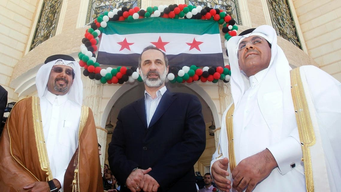 Syrian National Coalition leader Moaz Alkhatib (C) attends the opening of its embassy in Doha. A Syrian opposition bloc recognized by the Arab League as the sole representative for Syria opened its first embassy in Qatar on Wednesday. (Reuters)