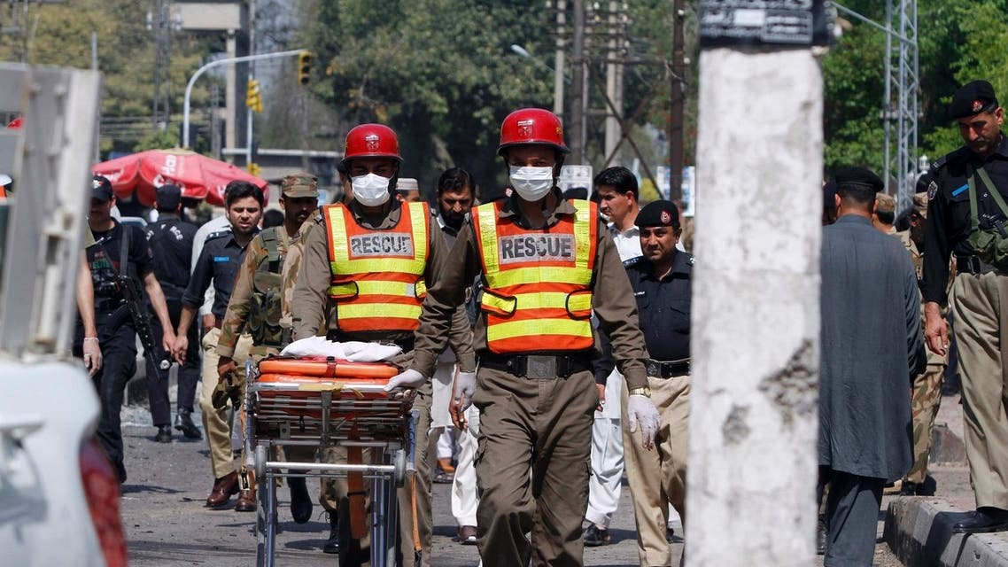 Rescue workers transport body parts of blast victims from the site of a bomb attack in Peshawar. (Reuters)