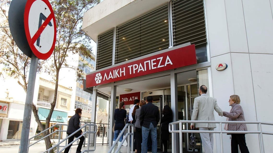 Depositors wait to enter a branch of Laiki Bank in Nicosia. Cypriots hoped for relaxation of the first capital controls in the Eurozone after authorities dropped domestic restrictions on credit card payments. (Reuters)