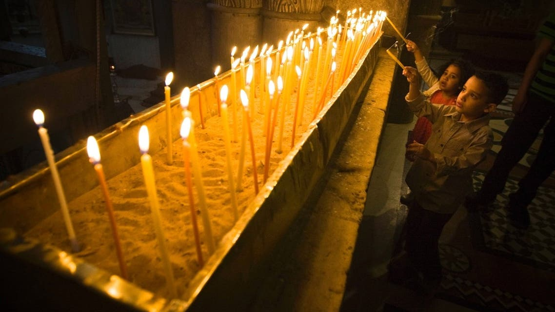 Young worshippers light candles during Easter Sunday mass at the Church of the Holy Sepulchre in Jerusalem's Old City March 31, 2013. (Reuters)