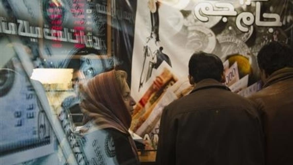 An Iranian woman stands in a currency exchange shop in northern Tehran, January 2012. (Reuters)