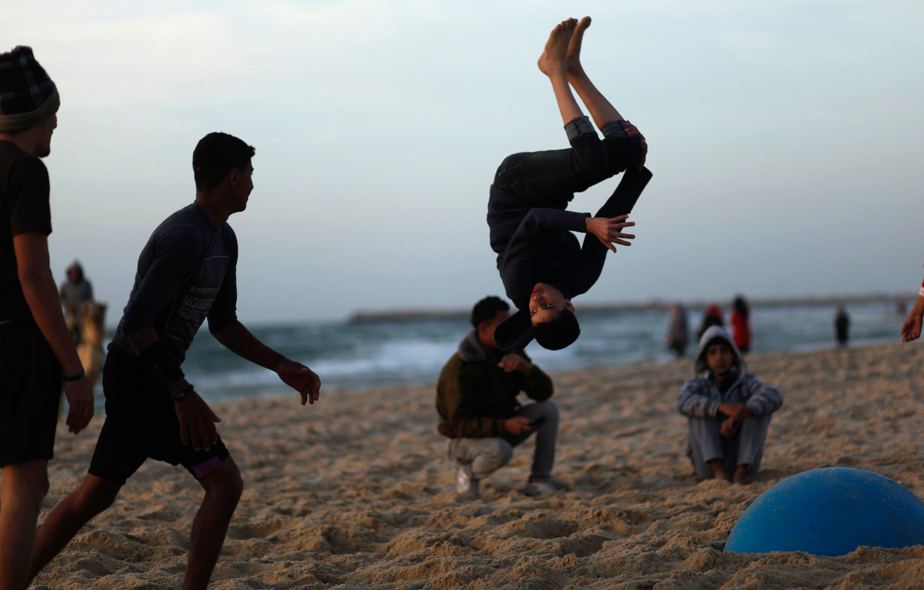 Youth in Gaza enjoy their beach time