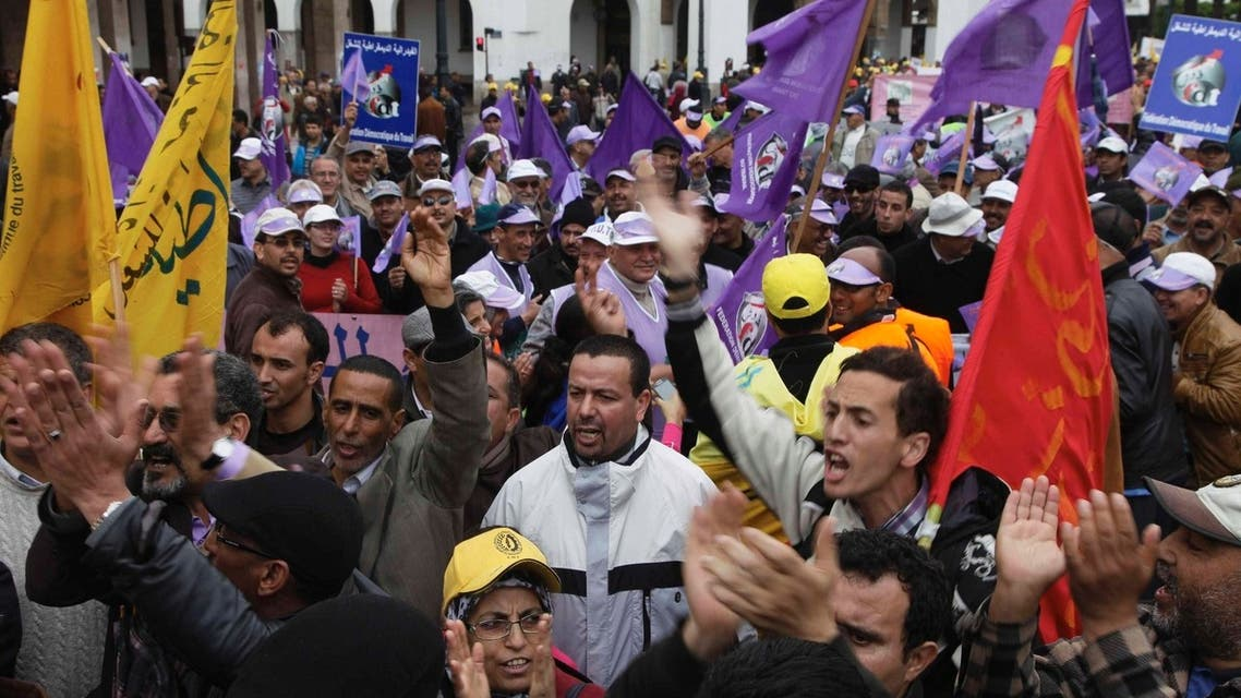 Protesters shout slogans during a demonstration in which they denounced government policies and demanded for rights and liberties in Rabat March 31, 2013. REUTERS/Stringer