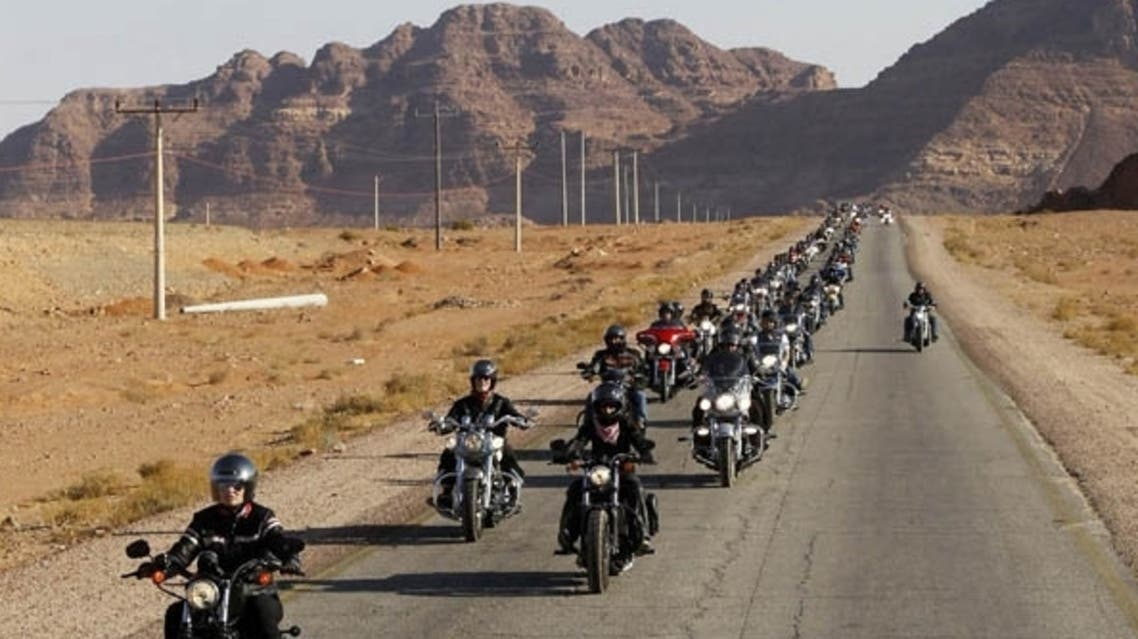 A convoy of some 200 Harley-Davidson bikers from all over the world ride through the desert in Wadi Rum, 320 km (200 miles) south of Amman,during the 1st annual Harley Davidson rally in Jordan. (Reuters)