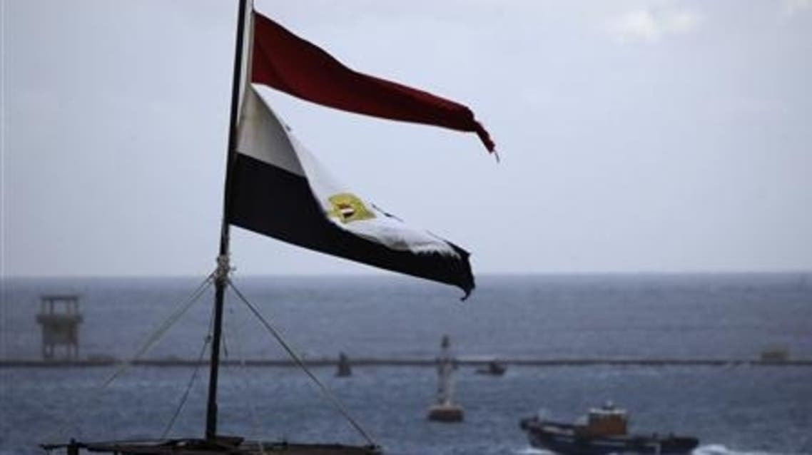 The Egyptian national flag flutters at Port Said, northeast of Cairo. (Reuters)