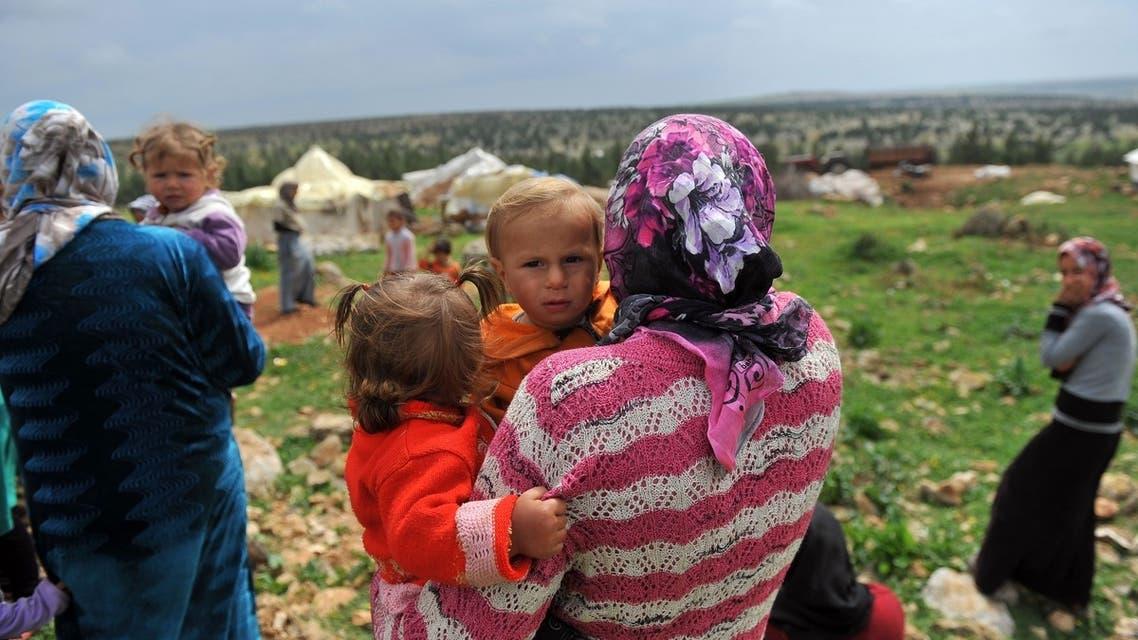 Syrian refugees near Afrin, on the Syria-Turkey border. (AFP)