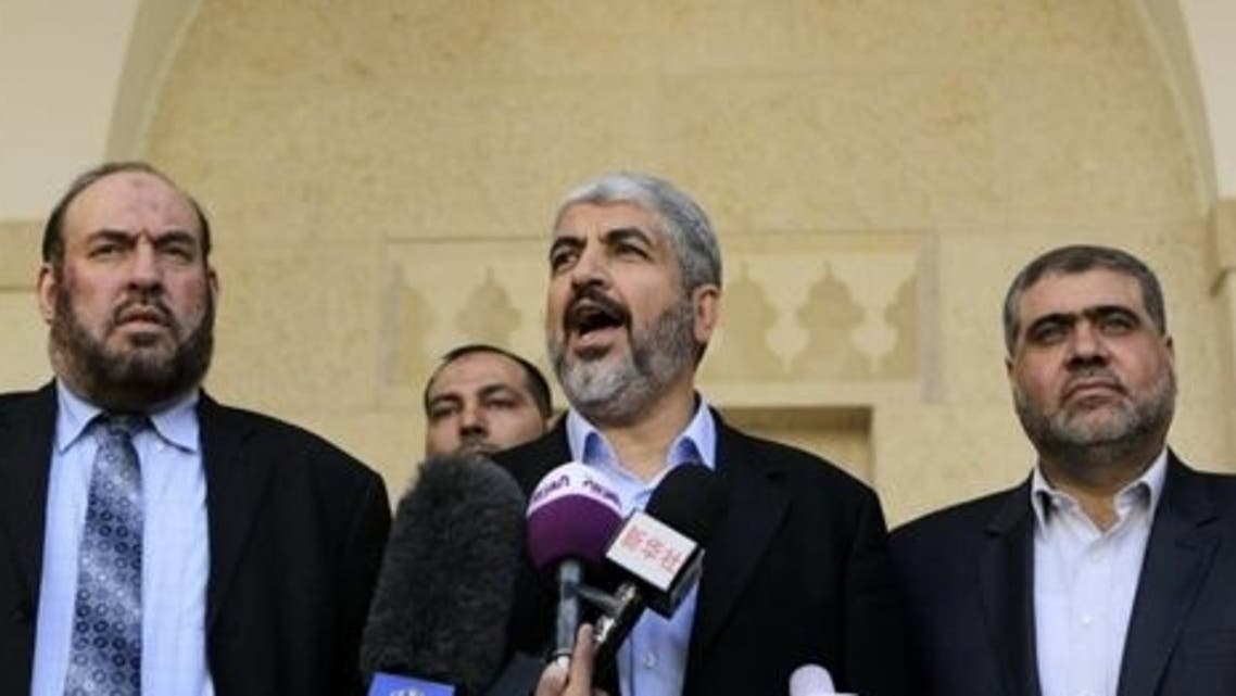 Hamas chief Khaled Meshaal (C) and members of Hamas' political bureau, Mohammed Nazzal (L) and Mohammed Nasser (R) speak to reporters following their meeting in Amman. (AFP)