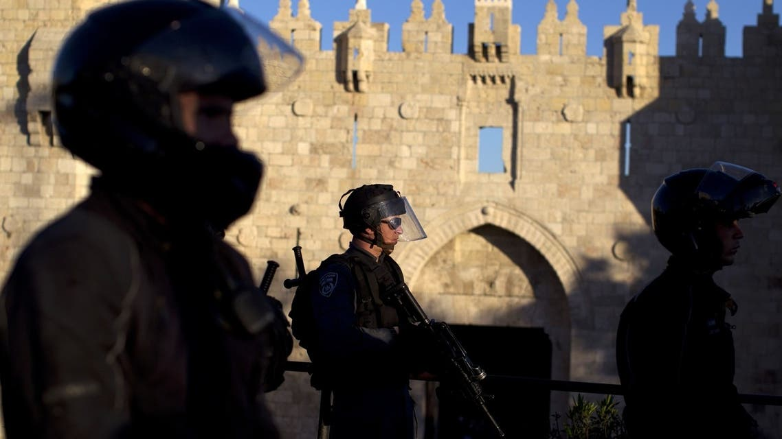 Israeli police in al-Qasa (AFP)