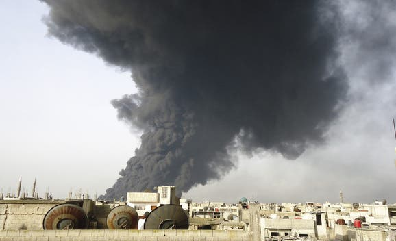 An undated photo shows black smoke rising from Homs refinery. (File photo: Reuters)