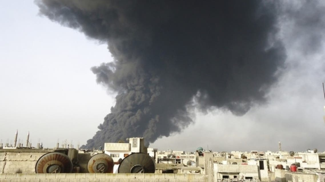 Black smoke is seen from Homs refinery. (Reuters)
