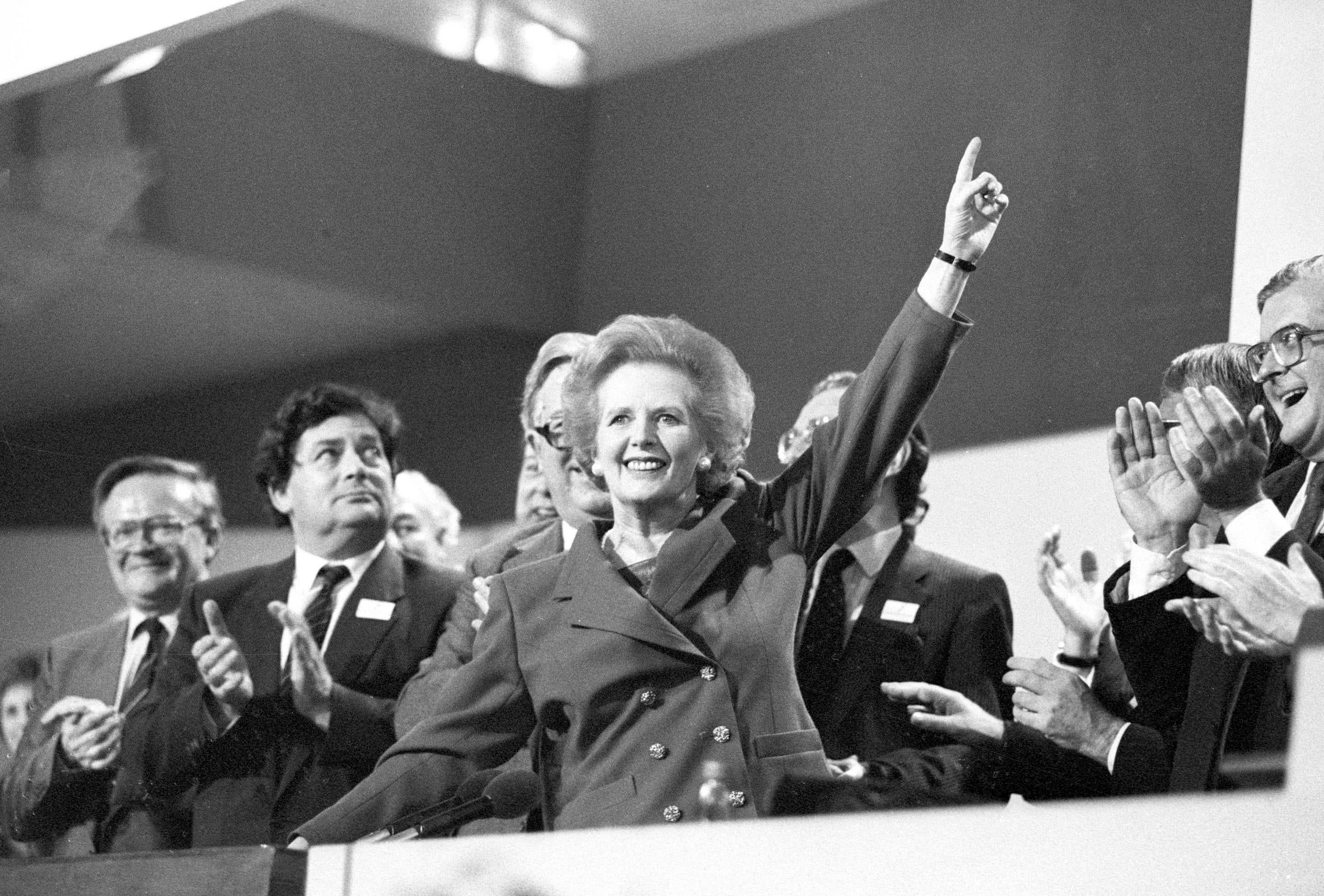 Then British Prime Minister Margaret Thatcher points skyward as she receives standing ovation at Conservative Party Conference in this October 13, 1989 file photo. Thatcher has died following a stroke, a spokesman for the family said. (Reuters)