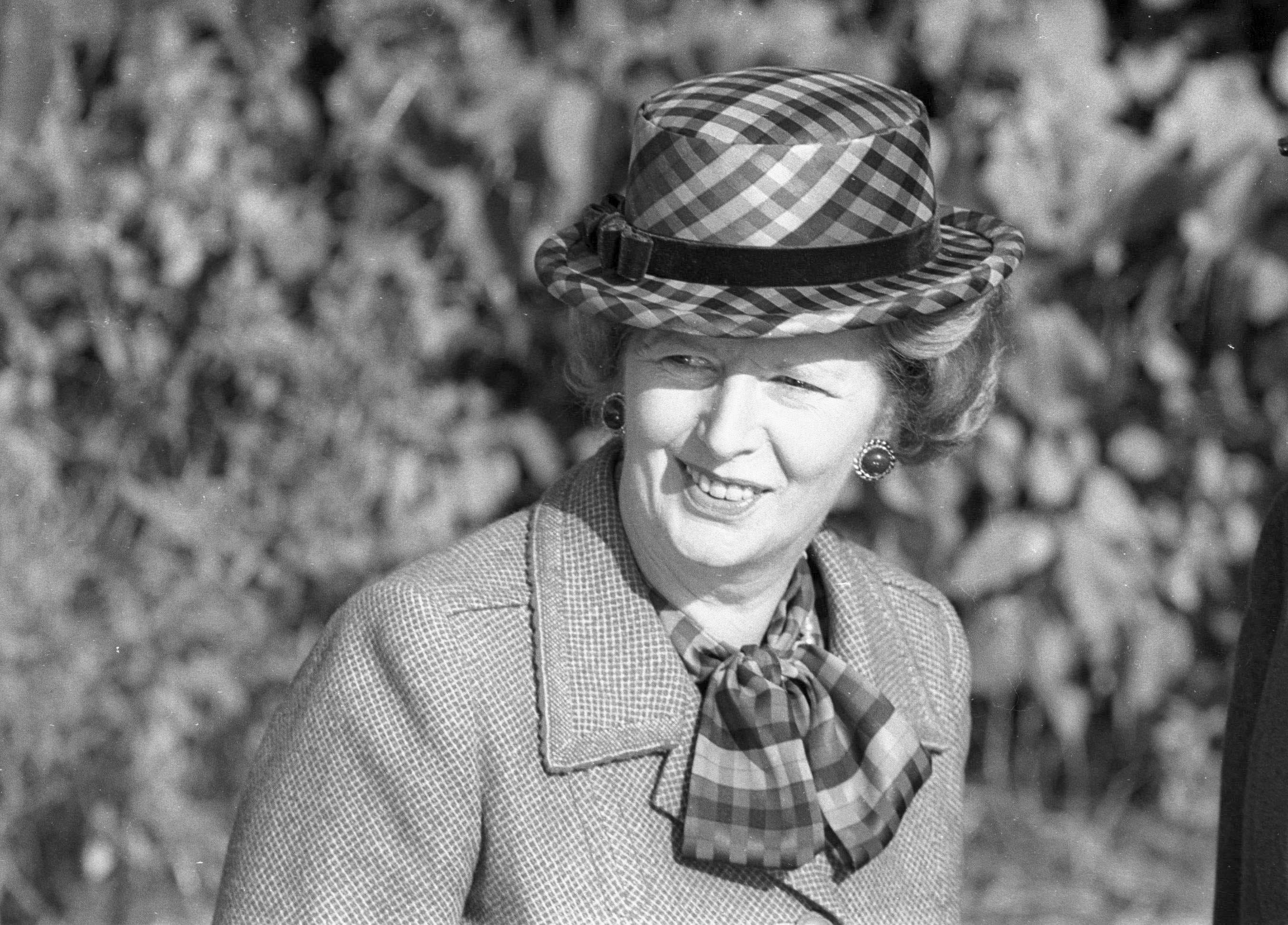 Then Britain's Prime Minister Margaret Thatcher wears a checkered green hat on her 60th birthday as she attends church near her official country residence, Chequers, near Aylesbury, England in this October 13, 1985 file photo. (Reuters)