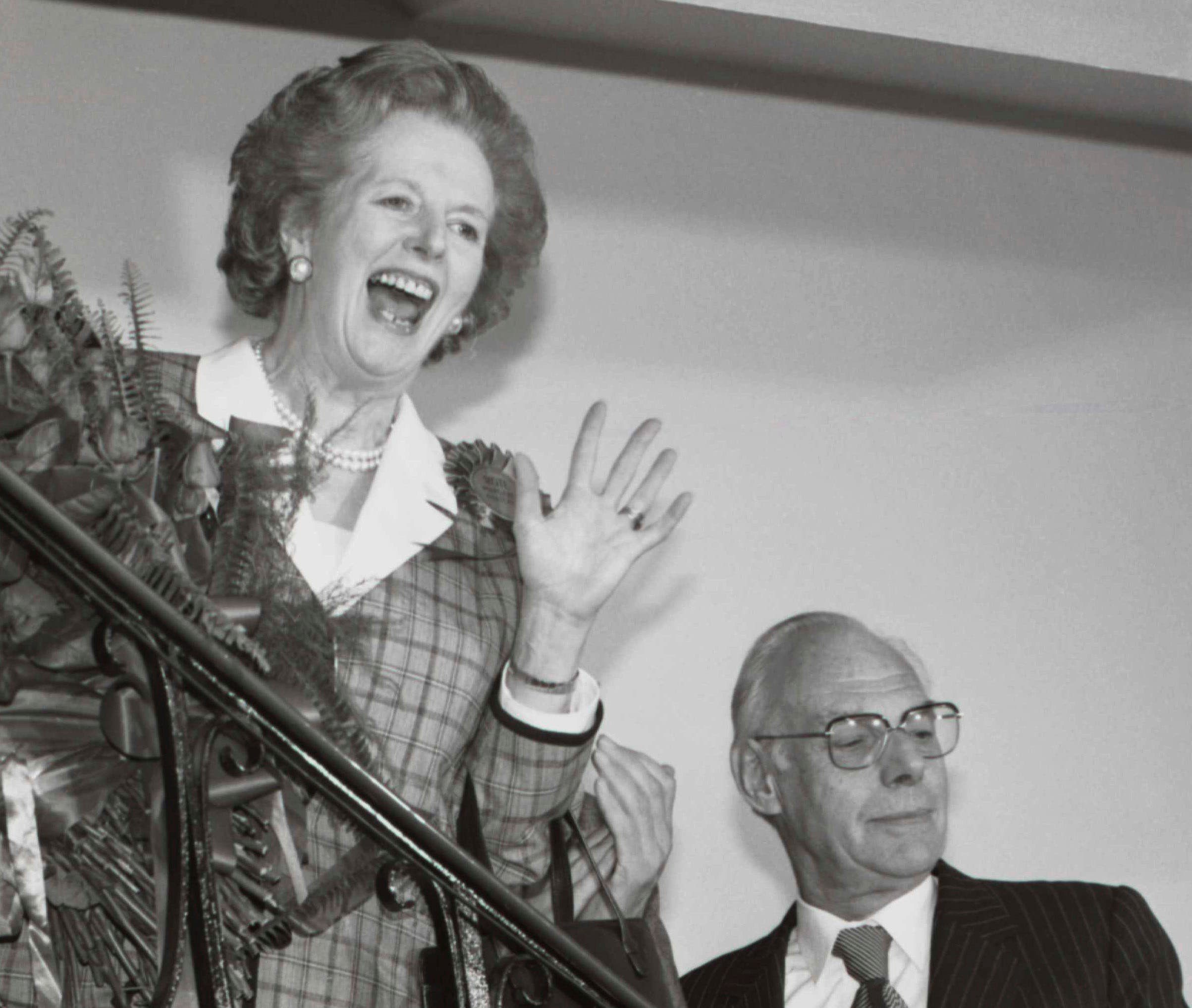 Britain's Prime Minister Margaret Thatcher gives a jubilant wave from the stairs inside her Conservative party headquarters in London early in this June 12, 1987 file photo, after sweeping back to power for a third consecutive term of office after the general election. (Reuters)