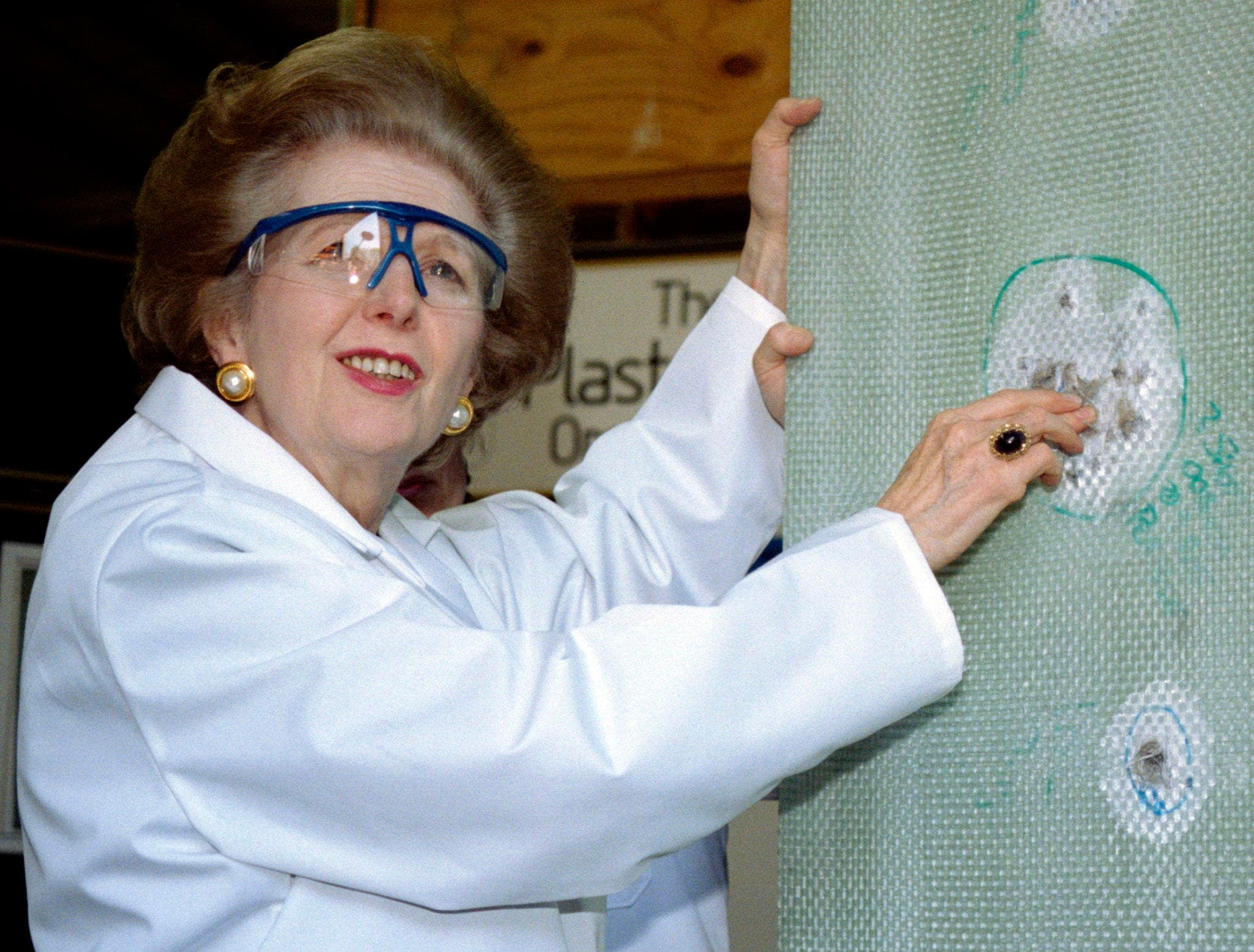 Baroness Thatcher examines a sheet of bullet-proof material during a visit to a factory producing ballistic and blast protection products in this April 9, 1997 file photo. (Reuters)
