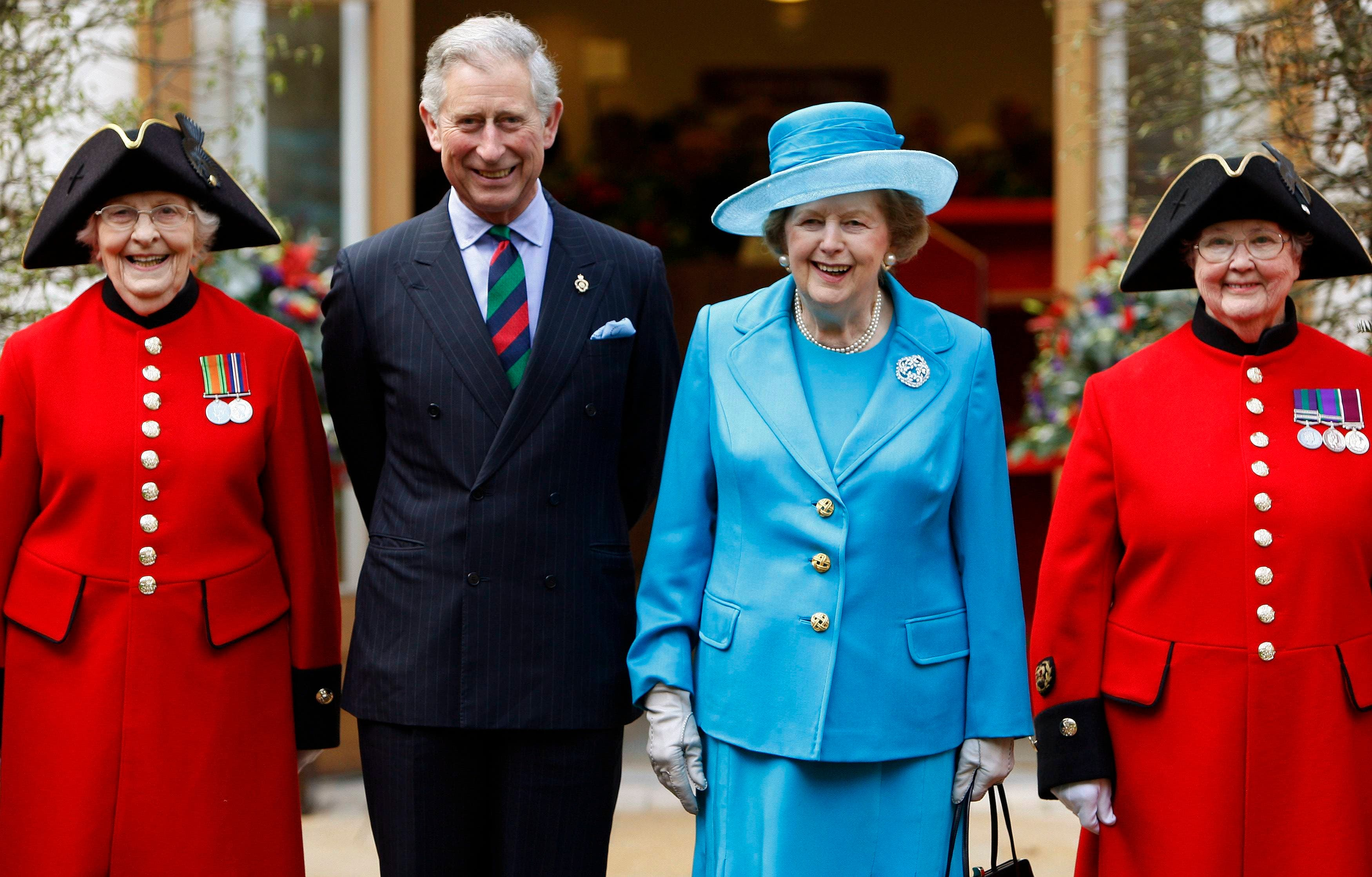 Britain's Prince Charles (2nd L) and former Prime Minister Margaret Thatcher (2nd R) pose with Chelsea pensioners Dorothy Hughes (L) and Winifred Phillips as they attend the opening of a new infirmary at the Royal Hospital Chelsea in London in this March 25, 2009 file photo. (Reuters)