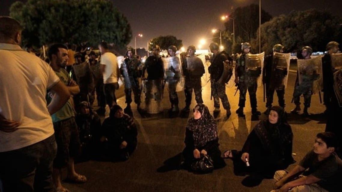 Relatives of Lebanese held in Syria block workers