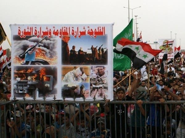 تظاهرات ضد المالكي تندد بإيران على وقع انفجارات