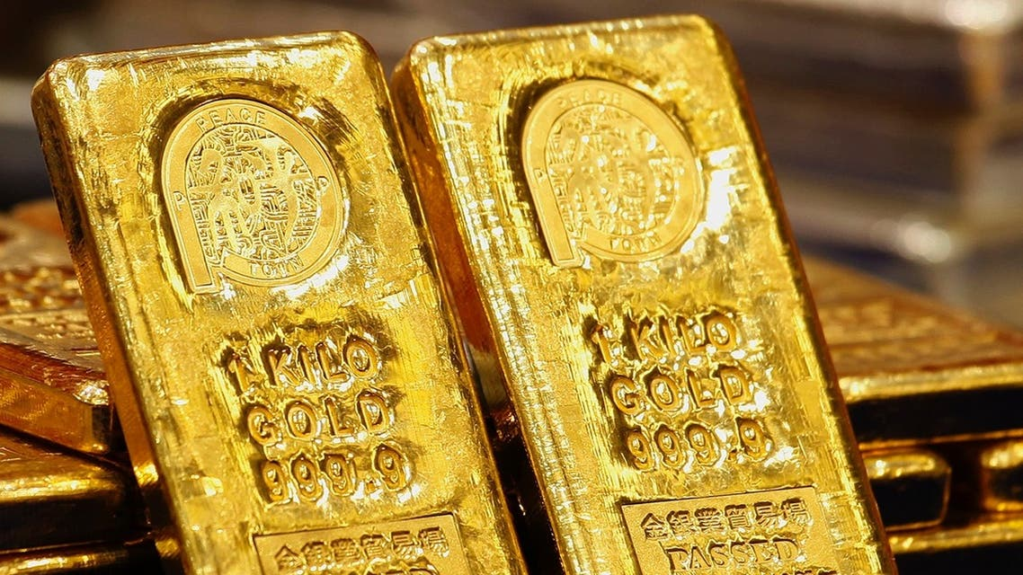 Gold bars displayed at the Chinese Gold and Silver Exchange Society. The gold price today sunk below $1,400. (Reuters)