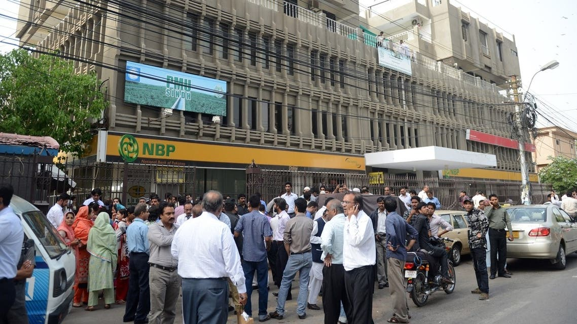 People evacuate buildings in Karachi following an earthquake on April 16. (AFP)
