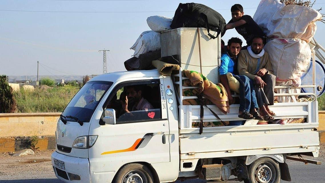 Syria men flee (Reuters)