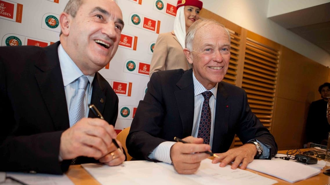 Jean Gachassin, president of the French Federation of Tennis and Tim Clark, president of Emirates (right) signed a five-year sponsorship agreement. (Image courtesy Emirates)