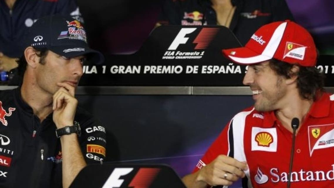 Red Bull F1 driver Webber jokes with Ferrari's F1 driver Alonso during a news conference at after a race. (Reuters)