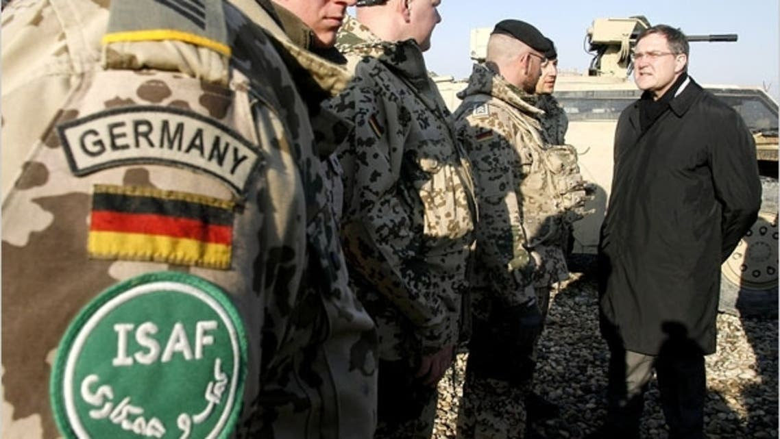 Franz-Josef Jung, Germany's defense minister, talking in late January with German soldiers in Mazar-i-Sharif, Afghanistan