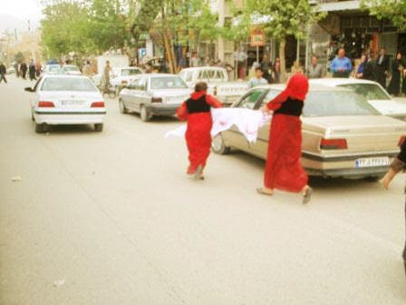 Pictures showing Kurdish activists wearing their traditional red costumes. (Photo courtesy NNSROJ news agency)