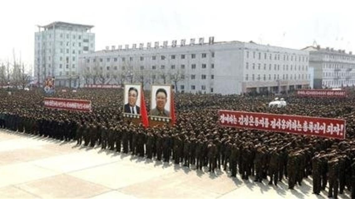 North Koreans attend a rally held to gather their willingness for a victory in a possible war against the United States and South Korea in Nampo, North Korea