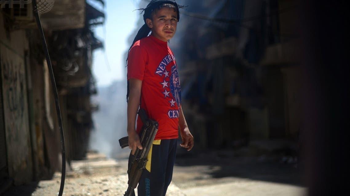 Syria AFP child with gun