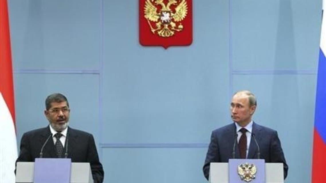 الرئيسان المصري محمد مرسي والروسي فلاديمير بوتين