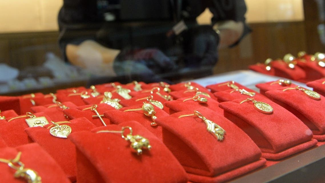 Pendants displayed at a shop in Singapore. The gold price has made five days of gains after the biggest slump in 30 years. (AFP)