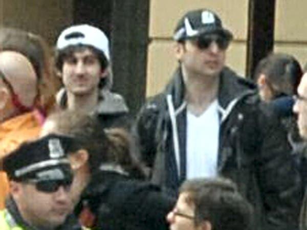 دجوهار (الى اليسار) مع شقيقه في ماراثون بوسطن