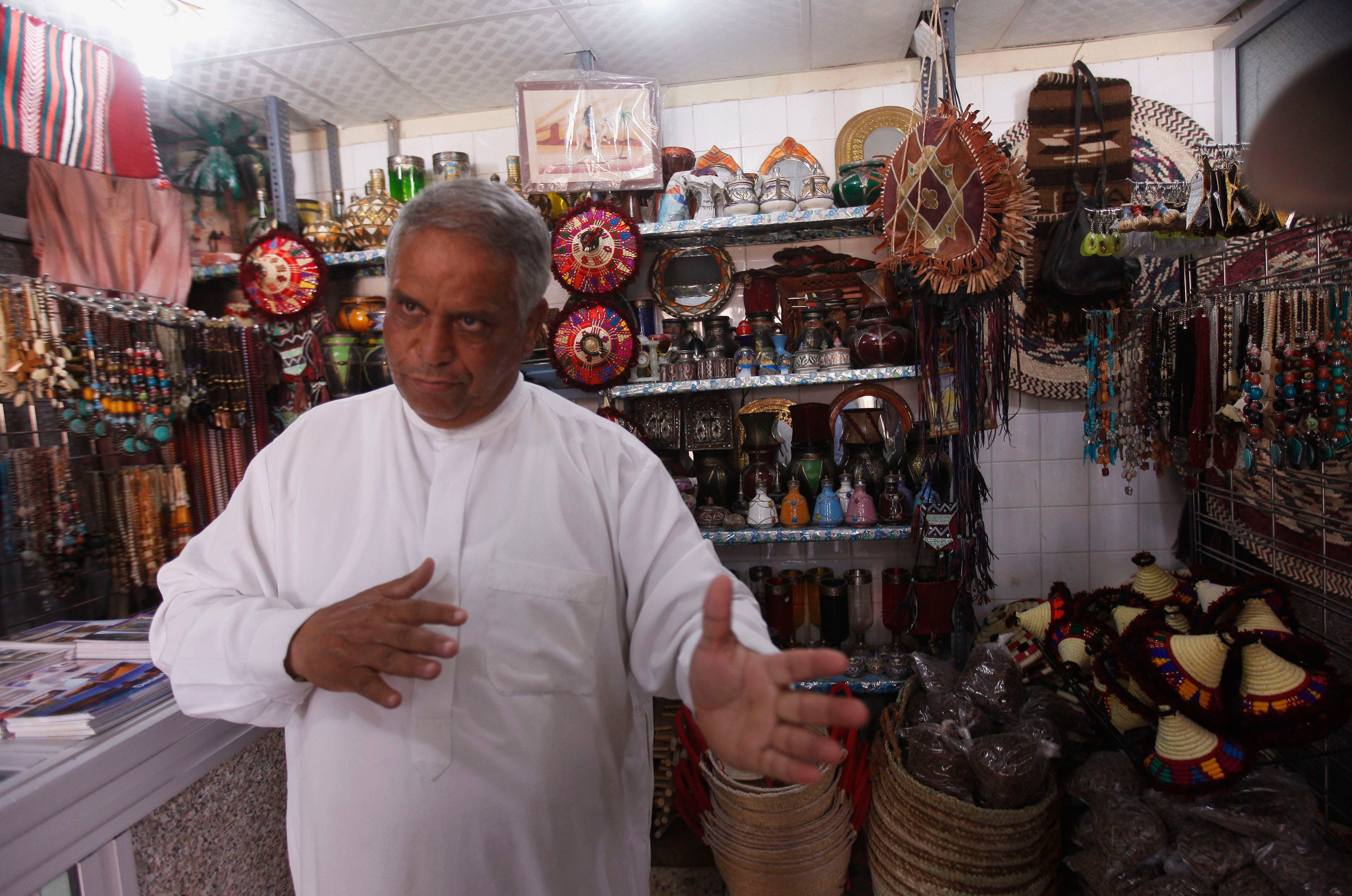 A shopkeeper, selling souvenirs and handicrafts, tends to his shop in the Libyan desert oasis town of Ghadames (Reuters)
