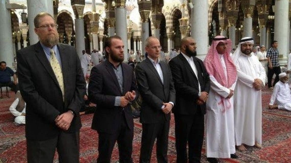 Arnoud van Doorn (C), a former leading member of far-right Dutch politician Geert Wilders' party, visited Saturday the Prophet's Mosque in Madinah to pray. (Facebook)