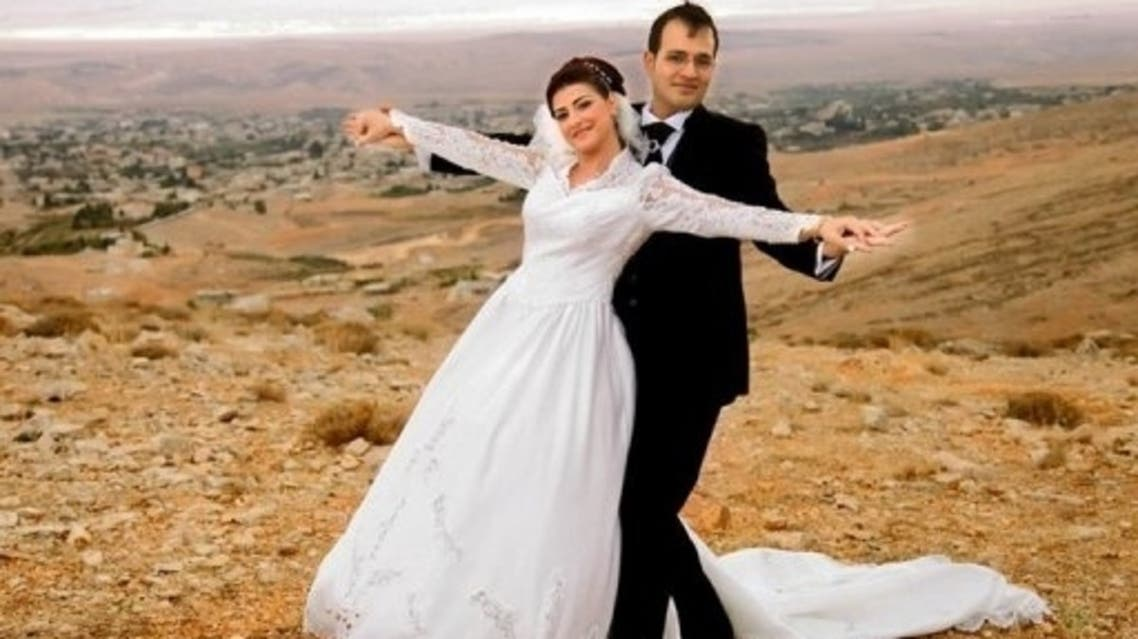 Kholoud Sukkariyeh (L) and Nidal Darwish pose for a photograph during a photoshoot at an undisclosed location (Darwish Family/AFP/file)