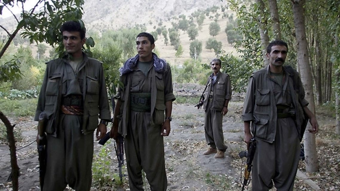 PKK fighters stand near the Qandil mountains near the Iraq-Turkish border. —Reuters