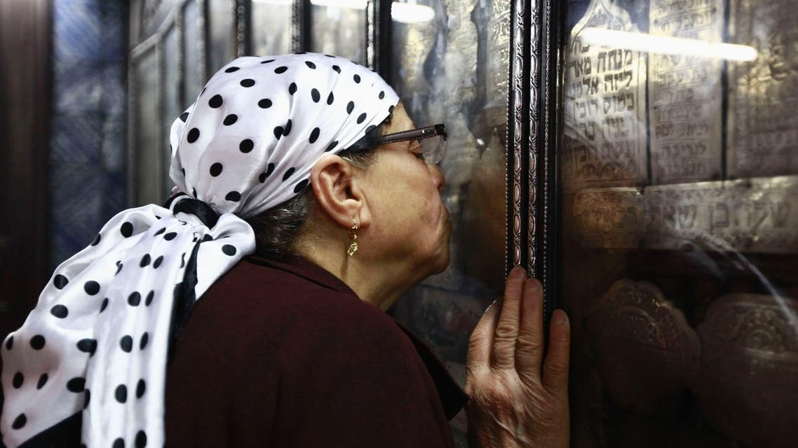 A Jewish woman prays as she kisses a religious icon on the first day of pilgrimage at the Ghriba synagogue in Djerba April 26, 2013. (Reuters)