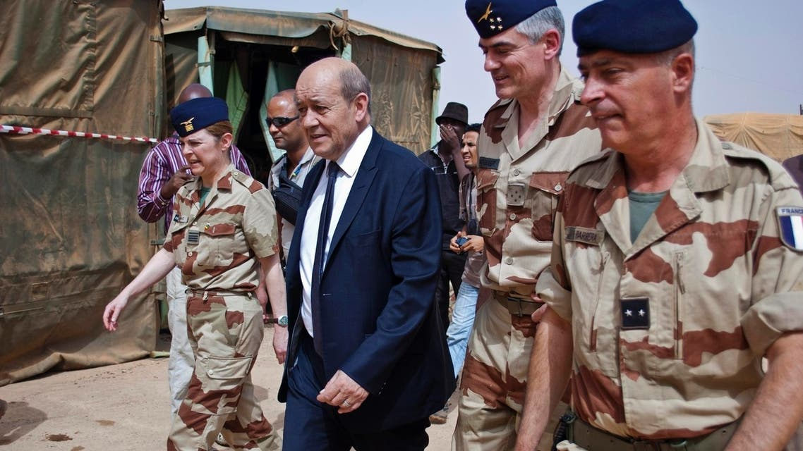 French Defence Minister Jean-Yves Le Drian (2nd L) arrives at the French military base at the airport in Gao April 26, 2013. (Reuters)