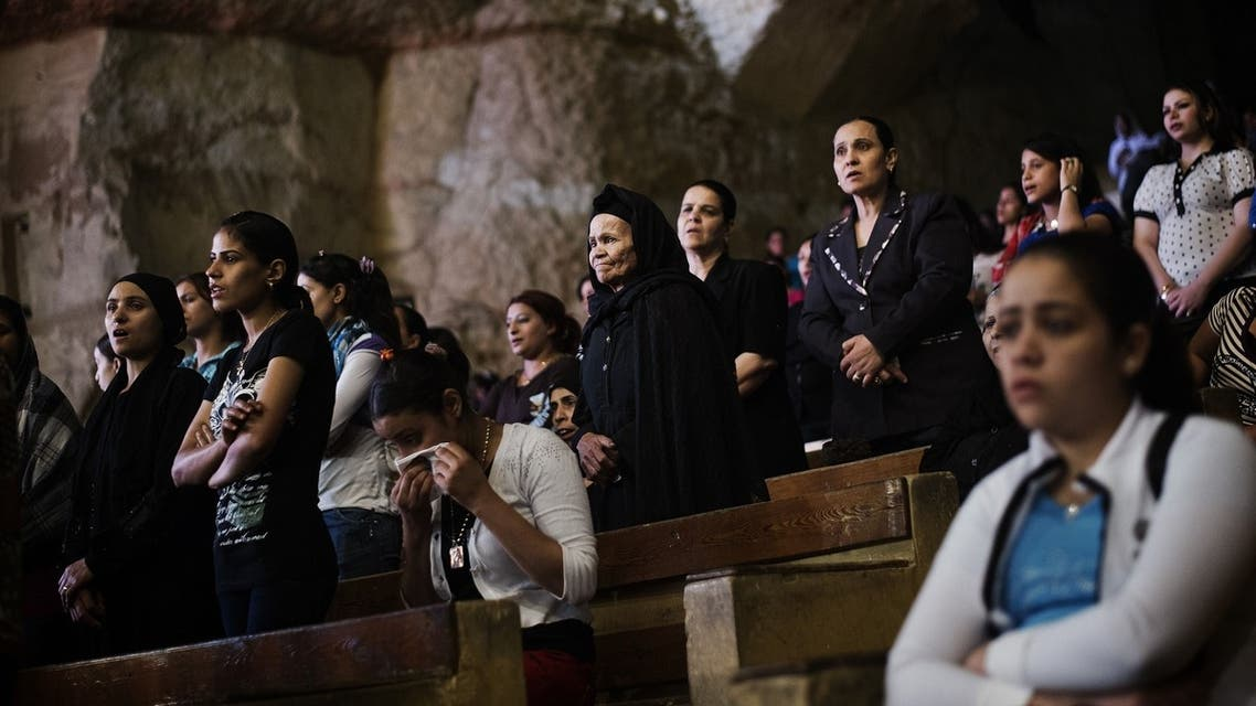 """gyptian Christian Coptic worshippers attend a function on April 25, 2013 at the St Samaans (Simon) Church also known as the Cave Church in the Mokattam village, nicknamed """"Garbage City,"""" in Cairo. (Reuters)"""