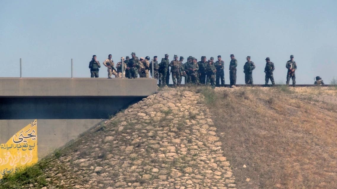 Kurdish security forces, called the Peshmerga, stand on the top of a hill on April 27, 2013 outside northern Iraqi city of Kirkuk. (AFP)