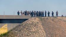 First Kurdish fighters enter Iraq from Turkey