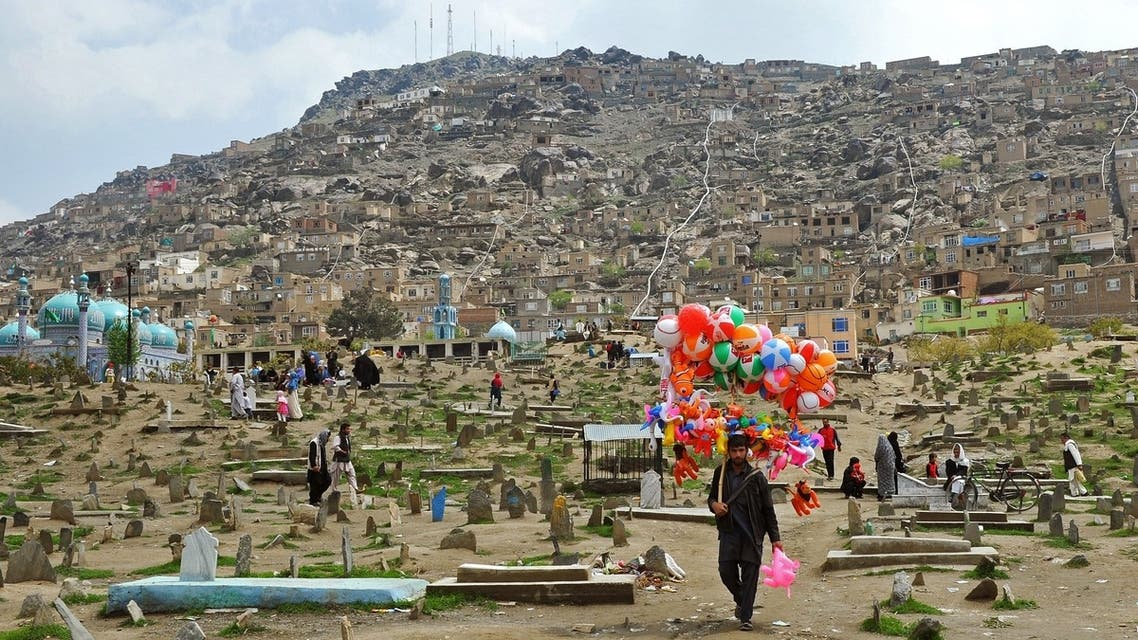 A street vendor sells balloons as he walks through the Karte Sakhi cemetary in Kabul. (AFP)