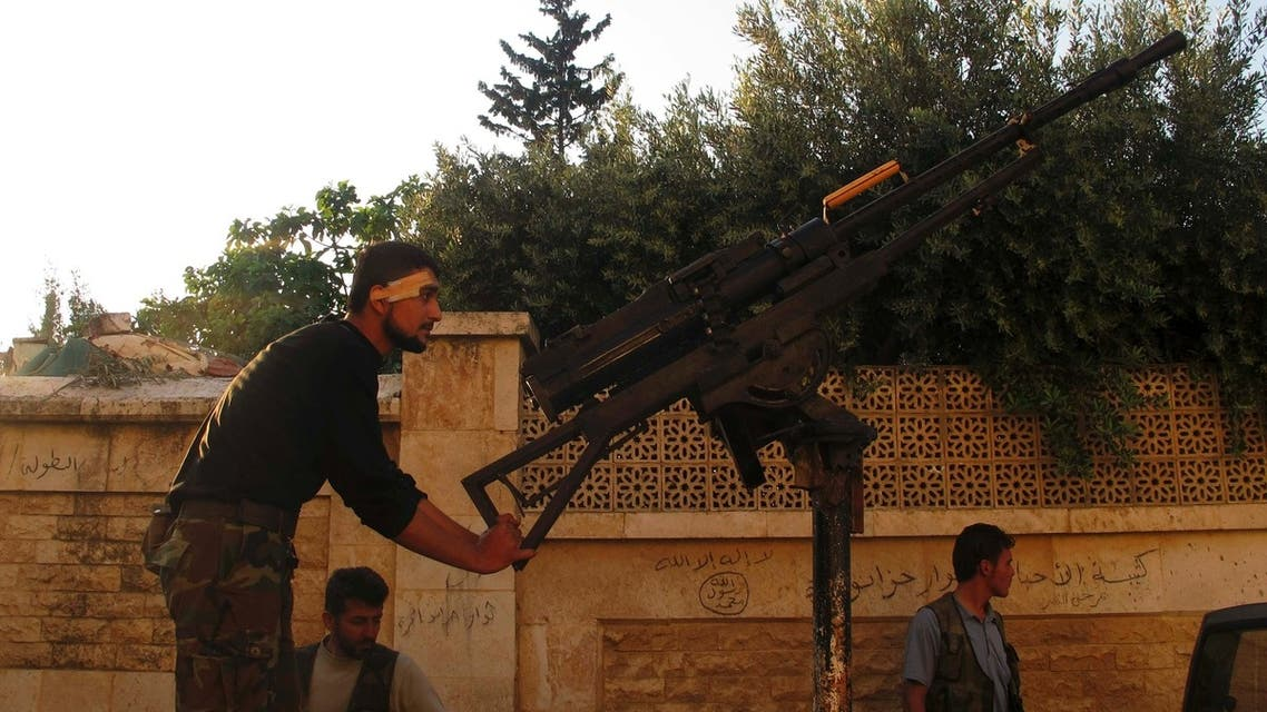 A Free Syrian Army fighter holds onto an anti-aircraft weapon in the Khan al-Assal area, near Aleppo April 27, 2013. (Reuters)