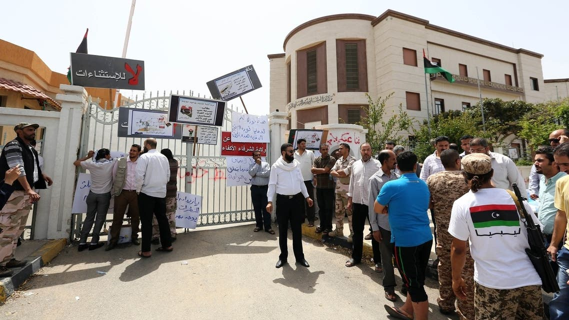 """A group of armed block the entrance of the foreign ministry as they demand it be """"cleansed of agents"""" and ambassadors of ousted dictator Moamer Kadhafi on April 28, 2013 in the Libyan capital Tripoli. (AFP)"""