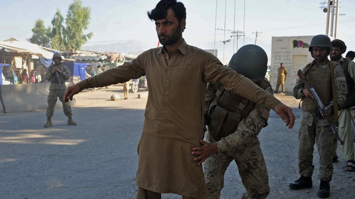 Afghan security personnel search a man at a checkpoint in the city of Jalalabad in Nangarhar province on April 28, 2013. (AFP)
