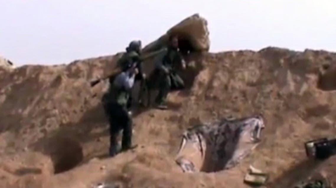 مسلحون من الجيش الحر أثناء الاشتباكات مع قوات النظام