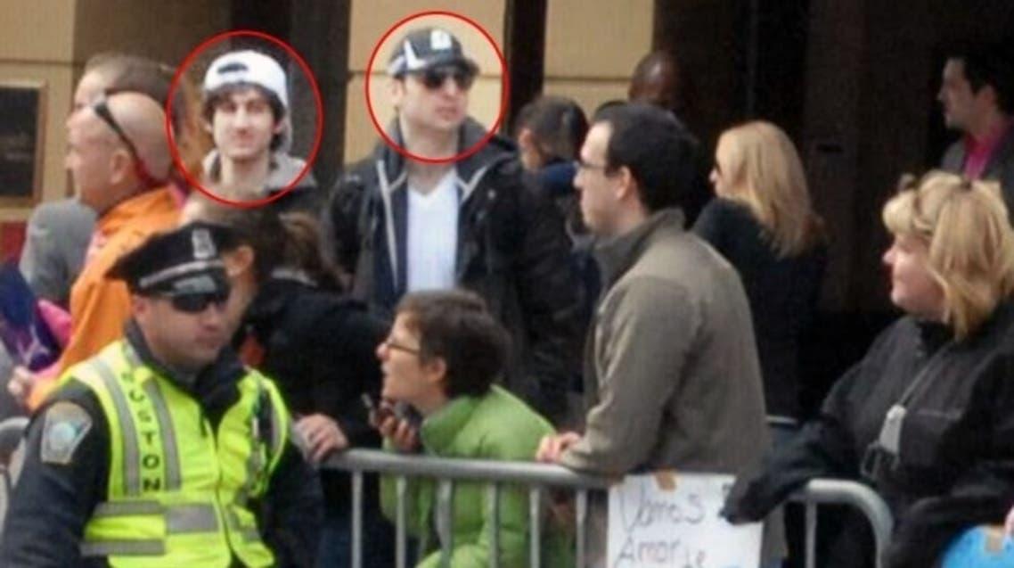Boston bombing suspects Tamerlan Tsarnaev, circled right, and Dzhokhar Tsarnaev, circled left, pictured during the marathon. (AP)