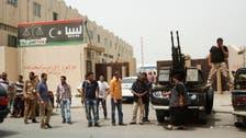 Libya militias pull guns from ministries, press protest