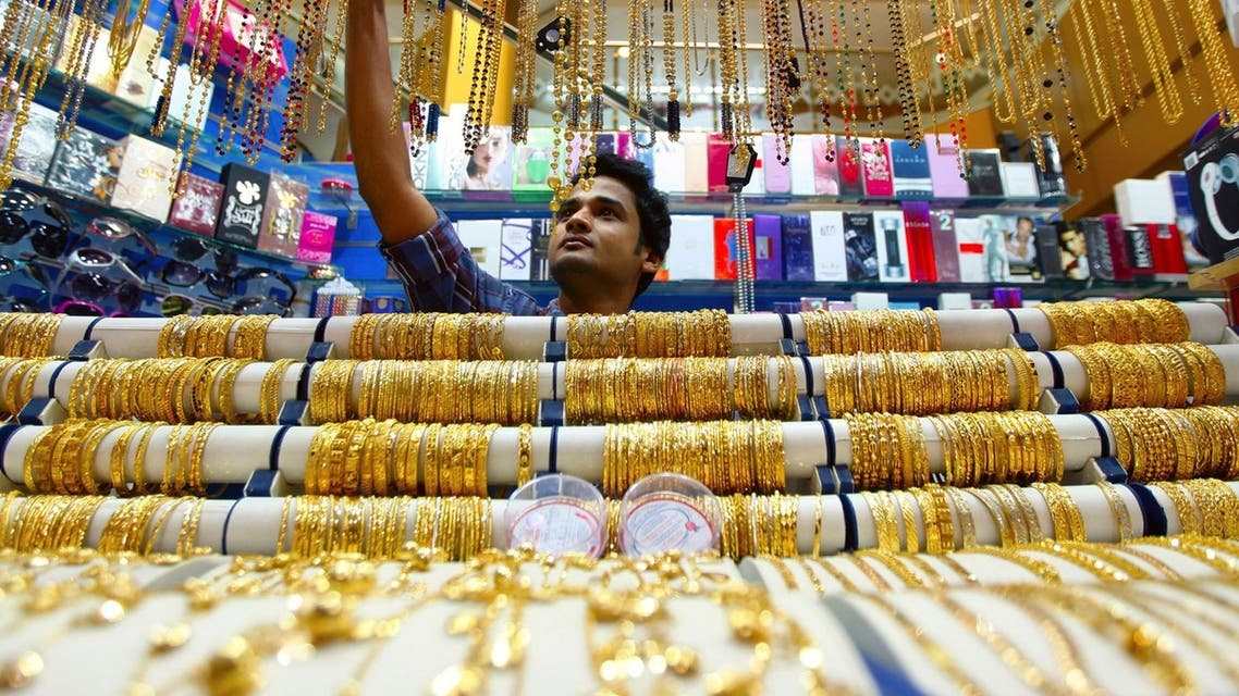 A salesman arranges jewelry at a shop at the gold souk in Deira, Dubai. The gold price today hold close to its lowest in almost a week. (Reuters)